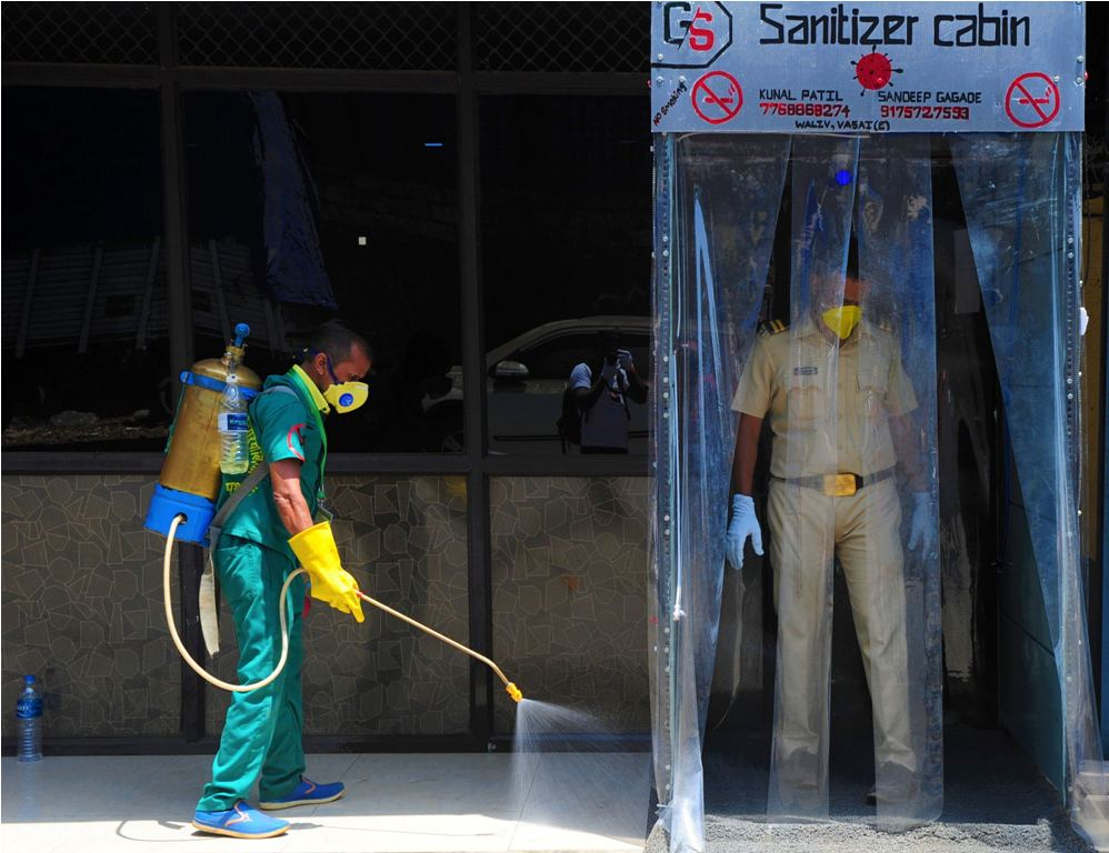 Palghar: A worker sprays disinfectant outside a sanitizer cabin to curb the spread of coronavirus, during the nationwide lockdown, in Palghar, Friday, April 10, 2020. (PTI Photo)(PTI10-04-2020_000203B)