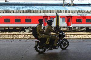 New Delhi: Policemen patrol on a bike along a stationed train during the nationwide lockdown, in wake of coronavirus pandemic, in New Delhi, Tuesday, April 7, 2020. (PTI Photo/Kamal Kishore)(PTI07-04-2020_000240B)