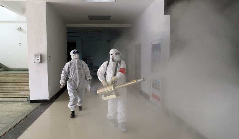 Volunteers in protective suits disinfect a residential compound in Wuhan, the epicentre of the novel coronavirus outbreak, in Hubei province, China. Reuters