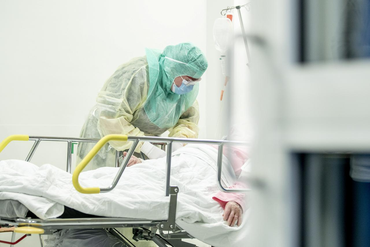 A nurse in protective gear takes a blood sample of a patient potentially infected with coronavirus disease (COVID-19) at the Turku University Hospital Tyks in Turku, Finland, April 3, 2020. Roni Lehti/Lehtikuva/via REUTERS