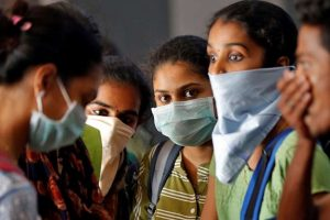 A group of students wearing protective masks wait to buy tickets at a railway station amid coronavirus fears, in Kochi, India, March 10, 2020. [Sivaram V/Reuters]