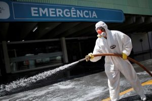 A member of the armed forces disinfects the entrance of a hospital during the coronavirus disease (COVID-19) outbreak in Brasilia, Brazil, March 31, 2020. (Photo: Ueslei Marcelino/Reuters)