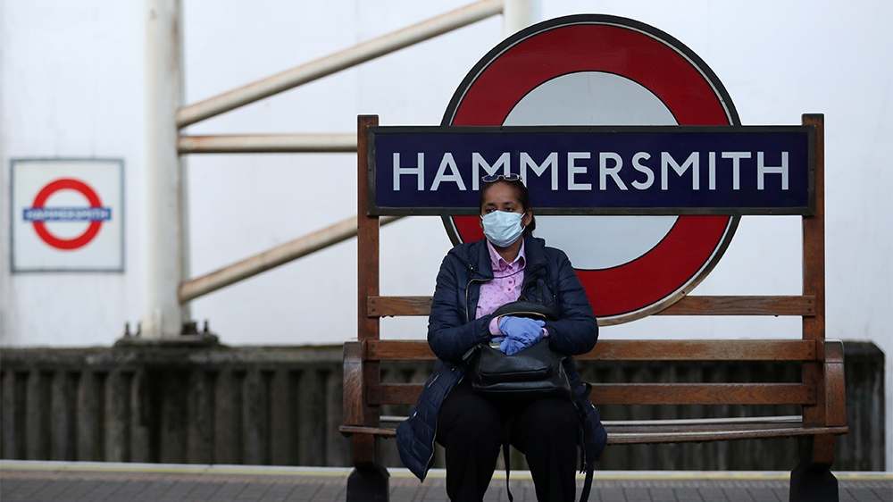 A commuter wearing a protective face mask at Hammersmith underground station as the spread of the coronavirus disease (COVID-19) continues, in London, the United Kingdom, on March 24, 2020 [Hannah McKay/Reuters]