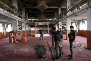 Afghan Sikh inspect inside a Sikh religious complex after an attack in Kabul, Afghanistan March 25, 2020, Reuters