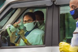 Kolkata: West Bengal Chief Minister Mamata Banerjee addresses from inside her car to m,ake people aware of the novel coronavirus, during ongoing nationwide lockdown, in Kolkata, Thursday, April 23, 2020. (PTI Photo/Ashok Bhaumik) (PTI23-04-2020_000115B)