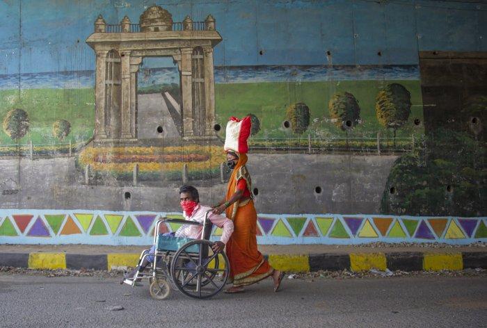 Migrants walk towards their native village during a nationwide lockdown, imposed in the wake of coronavirus pandemic, in Bengaluru. (PTI Photo)