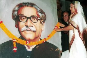 Bangladesh's Prime Minister Sheikh Hasina (R) puts a garland on the portrait of her father Sheikh Mujibur Rahman, Bangladesh's independence leader, at a national council meeting of ruling Awami League party in Dhaka June 23. Mujibur was killed in a 1975 army coup along with most of his family. His Awami League regained power after 21 years in 1996 when Hasina was elected the country's prime minister. Friday's meeting marked the 51st anniversary of founding of the League and completion of Hasina's four years in power. Hasina on Friday vowed to push for more economic, social and political reforms. She urged opposition parties to end their oycott of parliament and sit with the government to resolve differences.  AA/JDP