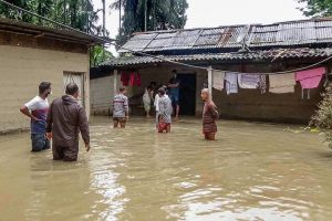 Nalbari: People outside their house in a flood-affected village in Nalbari district of Assam, Tuesday, May 26, 2020. (PTI Photo) (PTI26-05-2020_000206B)