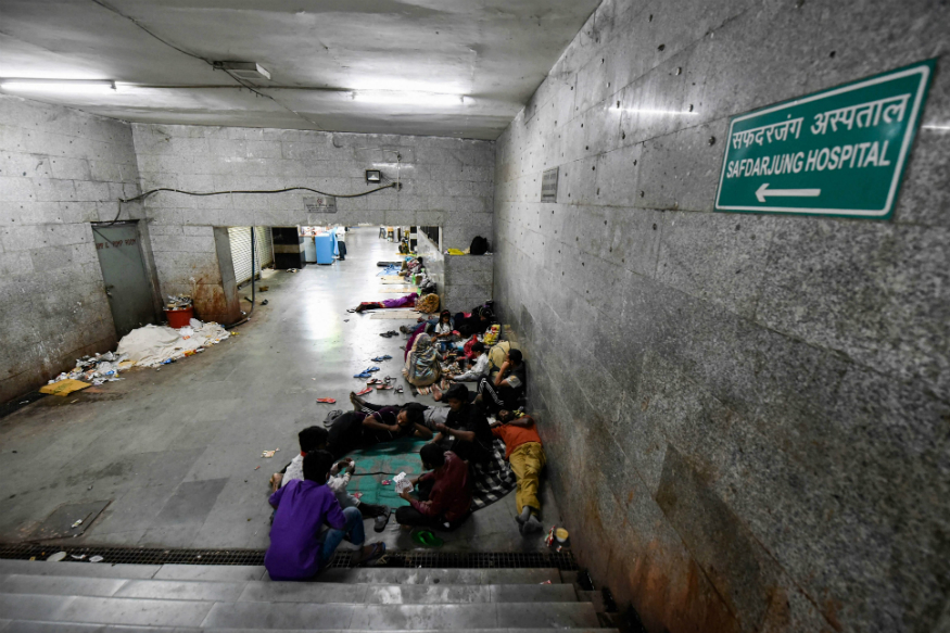 Discharged patients and their attendants, who were admitted to AIIMS, take refuge amidst unhygienic conditions at a subway near the hospital during the nationwide lockdown, in New Delhi on April 4, 2020. (PTI Photo/Manvender Vashist)