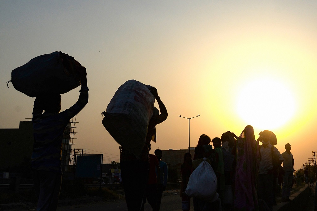 Jalandhar: Migrants with their luggage wait to board a special train to UP, arranged by the government, during the ongoing nationwide COVID-19 lockdown, in Jalandhar, Friday, May 8, 2020. (PTI Photo) (PTI08-05-2020_000296B)