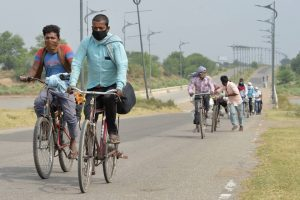 Chandigarh: Migrants from various districts of Uttar Pradesh ride bicycles to reach their native places, during the ongoing COVID-19 lockdown, in the outskirts of Chandigarh, Saturday, May 16, 2020. (PTI Photo)(PTI16-05-2020 000062B)