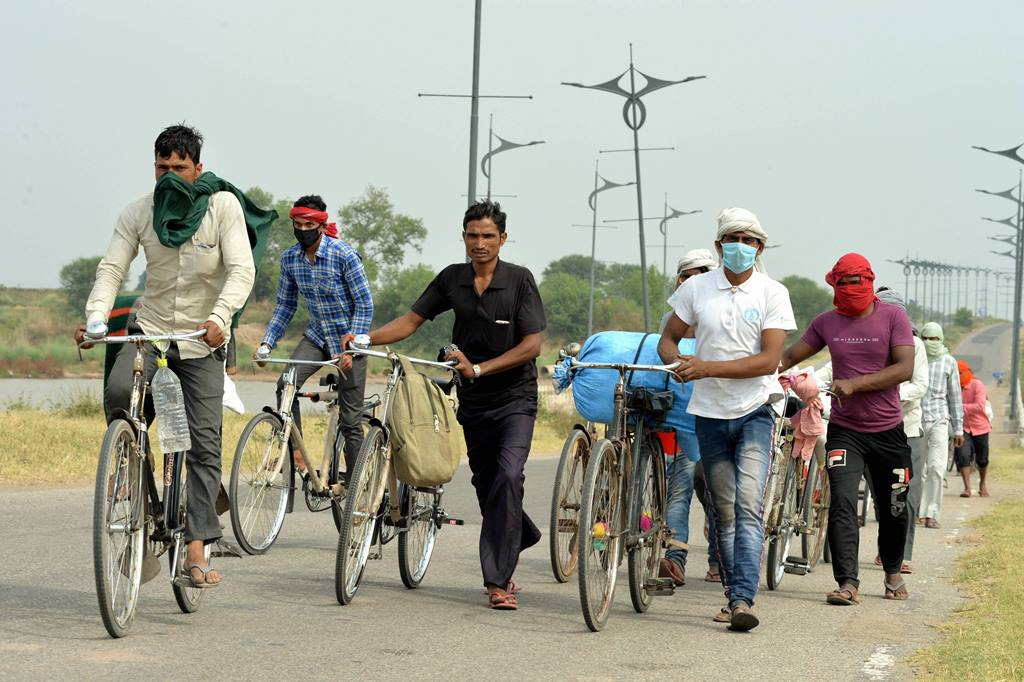 Chandigarh: Migrants from various districts of Uttar Pradesh ride bicycles to reach their native places, during the ongoing COVID-19 lockdown, in the outskirts of Chandigarh, Saturday, May 16, 2020. (PTI Photo)(PTI16-05-2020 000071B)