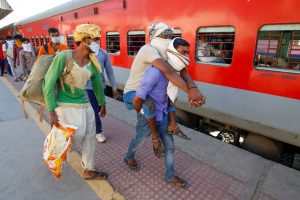 Ahmedabad: Migrant workers walk to board a special train to return to Agra, during a nationwide lockdown to curb the spread of coronavirus, at a railway station in Ahmedabad, Saturday, May 2, 2020. (PTI Photo)(PTI02-05-2020_000247B)