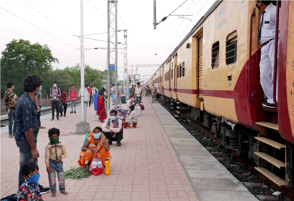 Bhopal: Migrants sit on Misrod railway station maintaining social distancing as they wait for their health-check after arriving from Nashik by a special train, during the ongoing COVID-19 lockdown, in Bhopal, Saturday, May 02, 2020. This is the first special train that has reached Bhopal after the Centres announcement to run such services to facilitate the stranded workers. (PTI Photo)(PTI02-05-2020 000019B)