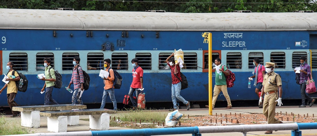 Kochi: Migrants board a train to their native places during the ongoing COVID-19 lockdown, at Aluva Station in Kochi, Saturday, May 2, 2020. (PTI Photo)(PTI02-05-2020_000178B)