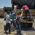 Thane : Migrants from various northern states board a truck at the Mumbai-Nashik highway to reach their native places, during the ongoing COVID-19 nationwide lockdown, in Thane, Monday, May 11, 2020. (PTI Photo/Mitesh Bhuvad)(PTI11-05-2020 000143B)