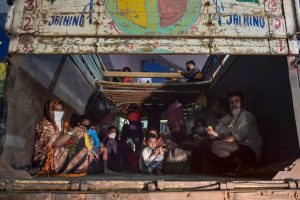 Thane: Migrants from various northern states board a truck at the Mumbai-Nashik highway to reach their native places, during the ongoing COVID-19 nationwide lockdown, in Thane, Monday, May 11, 2020. (PTI Photo/Mitesh Bhuvad)(PTI11-05-2020_000276B)