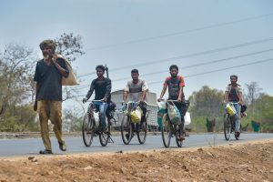 Thane: Migrants with their belongings ride on bicycles as they move towards their native places on the Mumbai-Nashik highway during the nationwide lockdown, in wake of the coronavirus pandemic, in Thane, Friday, May 1, 2020. (PTI Photo/Mitesh Bhuvad)(PTI01-05-2020_000219B) *** Local Caption ***