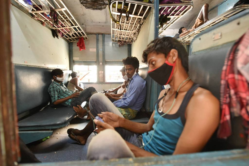 Lucknow: Migrants onboard a special train at Charbagh railway station, to travel to their native places, during the ongoing COVID-19 lockdown, in Lucknow, Wednesday, May 27, 2020. (PTI Photo/ Nand Kumar)(PTI27-05-2020 000191B)