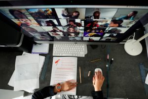 A student takes classes online with his companions using the Zoom app at home in El Masnou, north of Barcelona, Spain April 2, 2020. REUTERS/Albert Gea