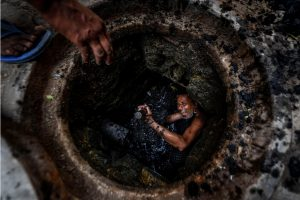 Ghaziabad: Phoolu (45), a full-time worker shows his hands after cleaning a manhole, during the ongoing COVID-19 lockdown, in Ghaziabad, Friday, May 01, 2020. Phoolu has a daughter and has been working since he was 10 years of age. He continues choicelessly to work inside sewer lines to earn a living amid this pandemic, exposing his body to added risk. (PTI Photo/Ravi Choudhary)(PTI01-05-2020_000090B)