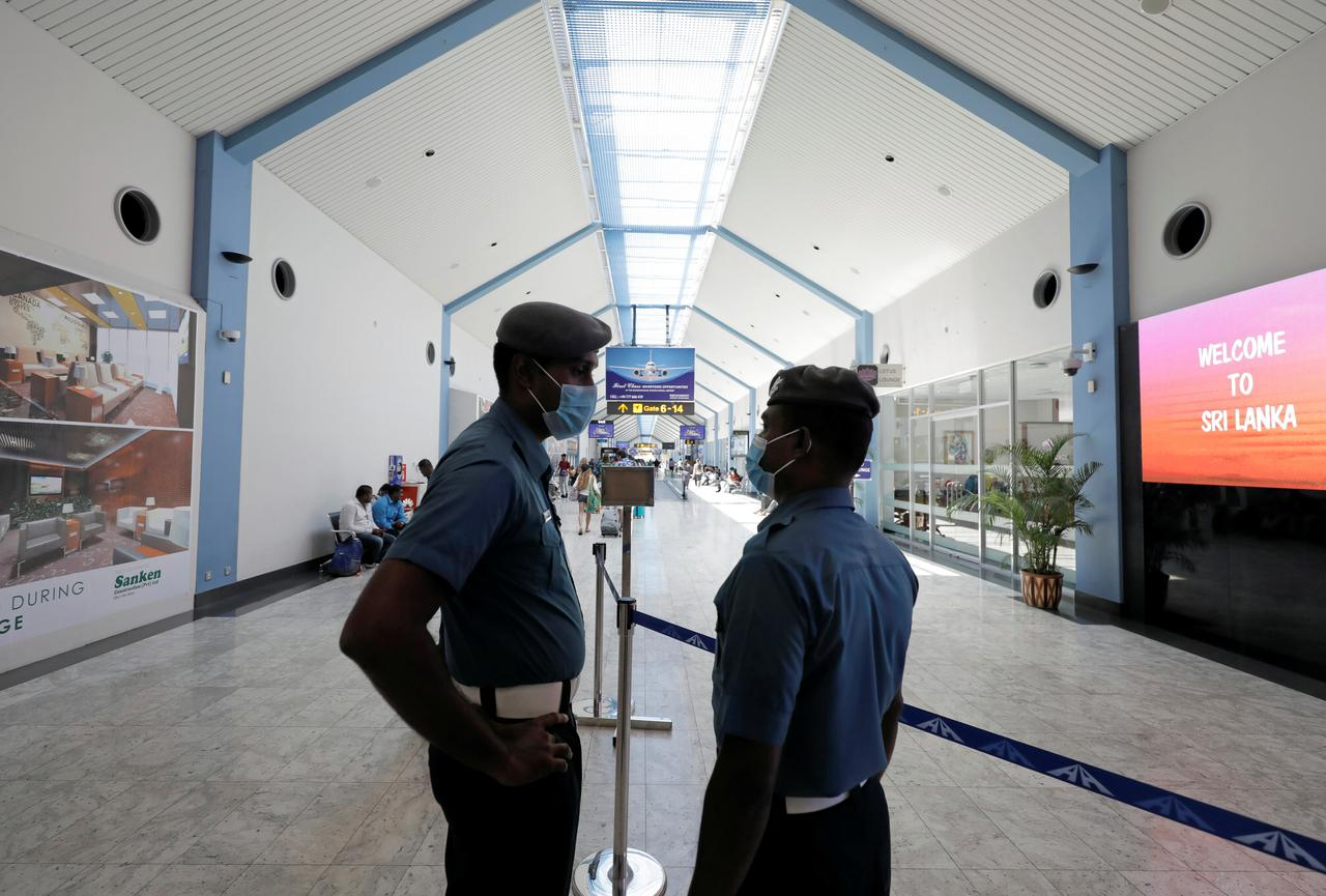 Security officials wear masks at Bandaranaike International Airport after Sri Lanka confirmed the first case of coronavirus in the country, in Katunayake, Sri Lanka January 30, 2020. REUTERS/Dinuka Liyanawatte/Files