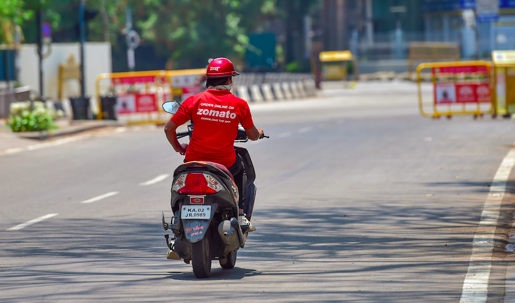 A food delivery man is seen on a deserted road during a nationwide lockdown imposed in the wake of novel coronavirus, in Bengaluru, Saturday, April 11, 2020. Photo: PTI