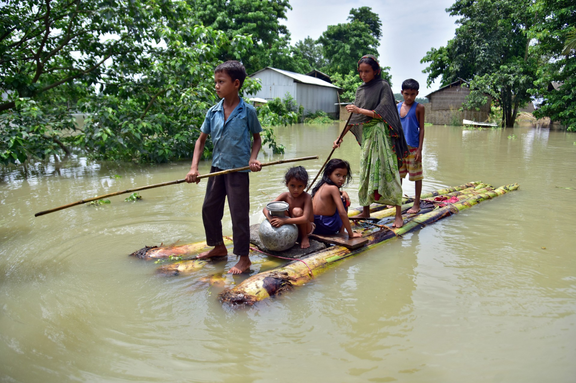 Villagers row a makeshift raft through a flooded field to reach a safer place at the flood-affected Mayong village in Morigaon district, in the northeastern state of Assam, India, June 29, 2020. REUTERS/Anuwar Hazarika