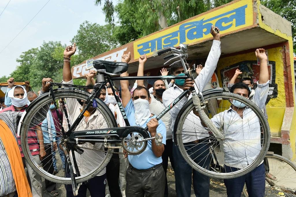 Ghaziabad: Workers shout slogans during a protest outside the factory after the manufacturers of famous Atlas Cycles shut their operations due to financial constraints on Wednesday, in Ghaziabad, Thursday, June 4, 2020. The company was facing financial crisis from the past many years even after the closure of its Malanpur unit but with the shutting of the Sahibabad unit, it has closed down its last factory. (PTI Photo/Arun Sharma)(PTI04-06-2020 000064B)