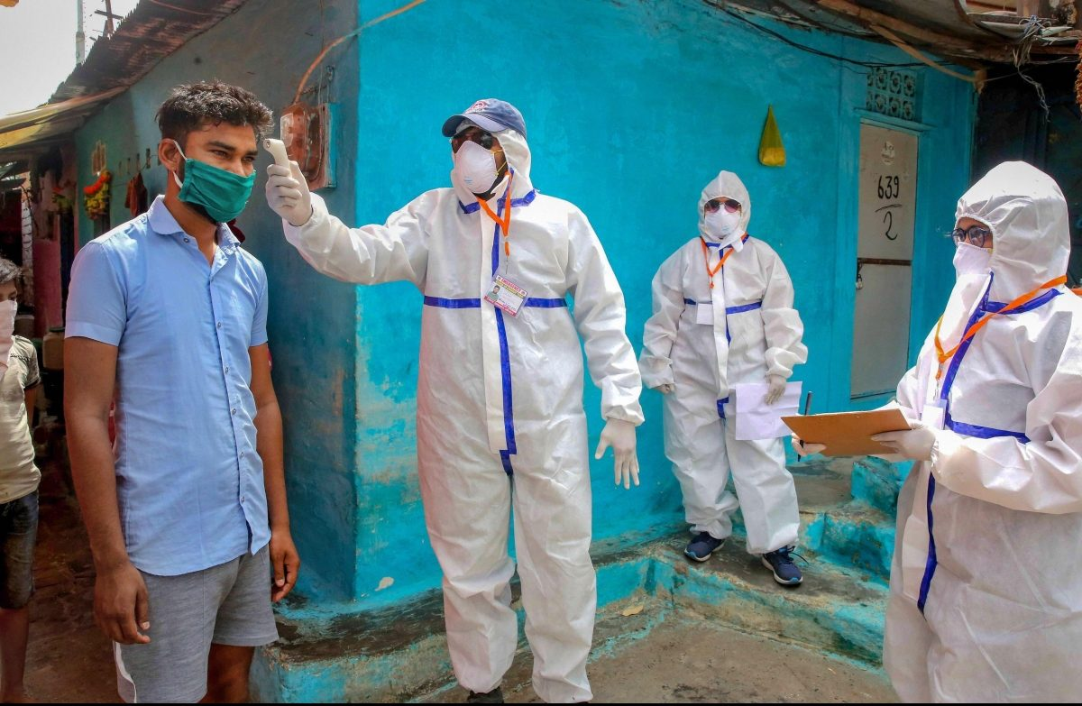 A team of doctors wearing protective suits check slum dwellers during a house-to-house health survey at Vallabh Nagar during the nationwide lockdown imposed in wake of the coronavirus pandemic in Bhopal Monday April 20 2020. (Photo   PTI)