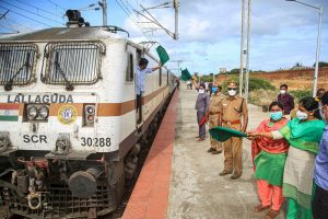 Kanyakumari: District administration officers DRO Revathi and RDO Mayil flag off a train carrying migrants to send them back to their native places in Assam, during the ongoing COVID-19 lockdown, in Kanyakumari, Tuesday, June 2, 2020. (PTI Photo)(PTI02-06-2020 000201B)