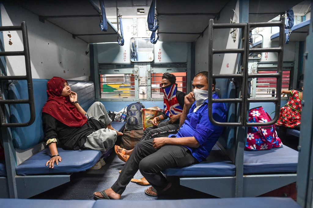 Lucknow: Passengers onboard a train at Charbagh railway station during COVID-19 lockdown 5.0, in Lucknow, Monday, June 1, 2020. Railways started its operation with 200 new trains from Monday, the first day of the 'Unlock 1' phase of the nationwide lockdown imposed to limit the spread of the Covid-19 coronavirus. (PTI Photo/ Nand Kumar)(PTI01-06-2020_000350B)