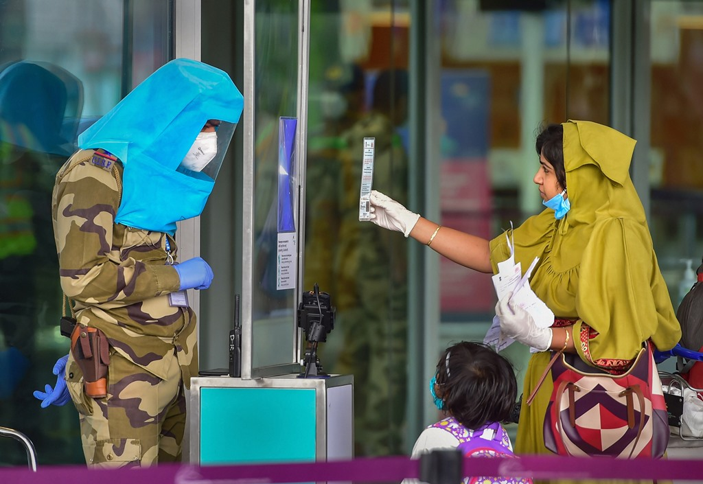 Bengaluru: A CISF personnel checks the ID of a passenger at Kempegowda International airport after authorities eased restrictions, during the ongoing COVID-19 nationwide lockdown, in Bengaluru, Tuesday, June 2, 2020. (PTI Photo/Shailendra Bhojak)(PTI02-06-2020_000209B)