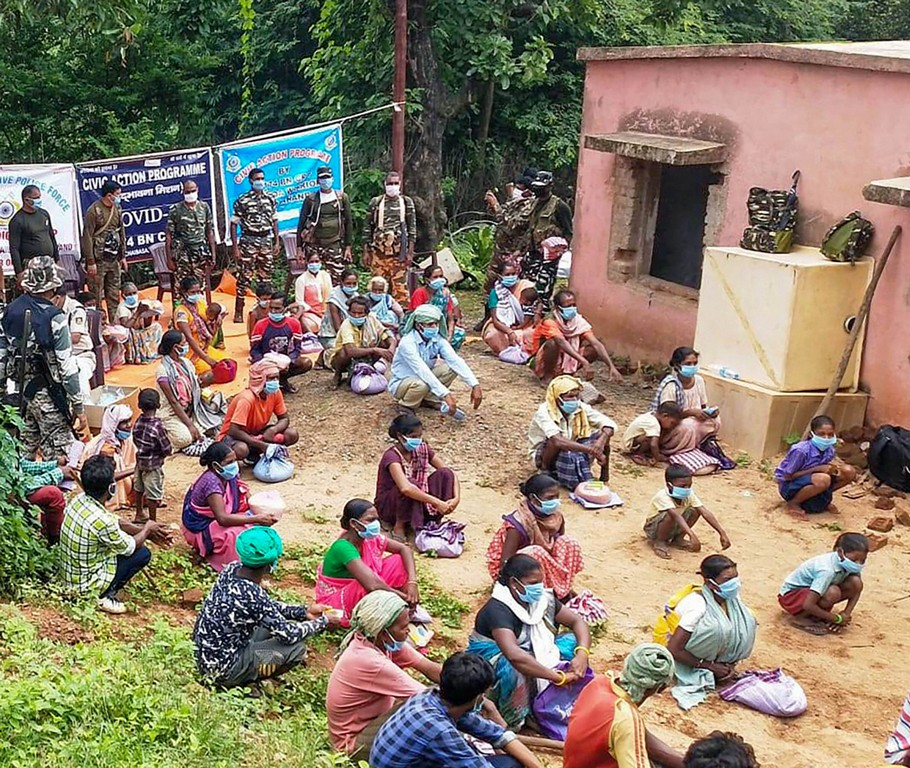 Chaibasa: People wait to collect ration and medicines, distributed by the Central Reserve Police Force (CRPF) personnel, at Gudri block in Chaibasa district, Saturday, June 27, 2020. PTI Photo)(PTI27-06-2020 000236B)