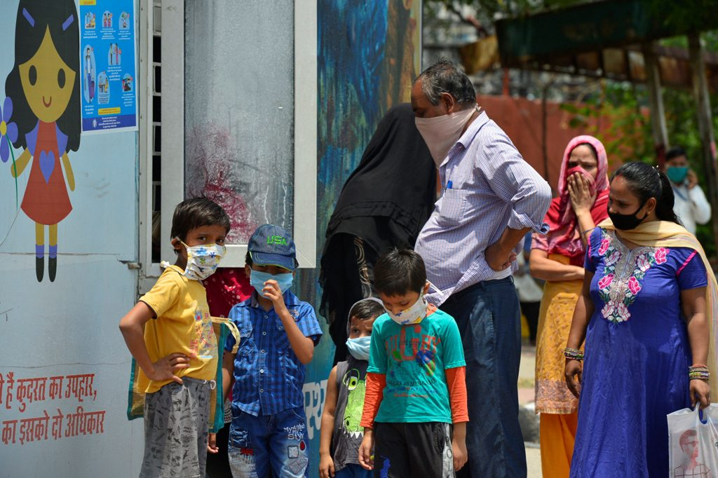 New Delhi: People wait at a Mohalla clinic to get medicines, during the fifth ongoing COVID-19 lockdown, in New Delhi, Wednesday, June 10, 2020. (PTI Photo/Kamal Kishore)(PTI10-06-2020 000115B)