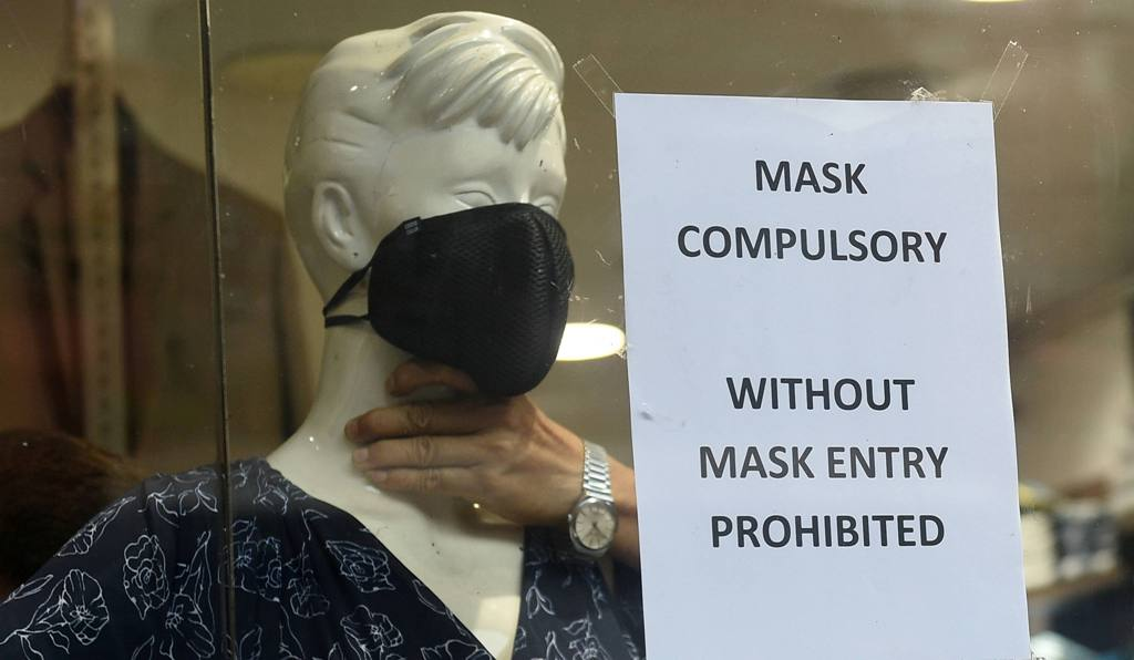 Kolkata: A notice on No Entry Without Mask is placed next to a mannequin with a face mask on it at a shop, during Unlock 1.0, in Kolkata, Saturday, June 27, 2020. (PTI Photo/Ashok Bhaumik)