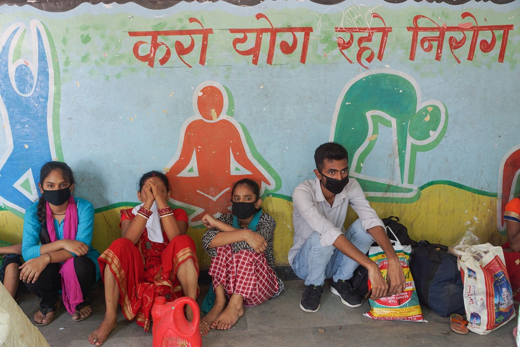 New Delhi: Migrants take refuge in a school while waiting for transport to reach their native places in different states, during the fifth phase of nationwide lockdown, in New Delhi, Saturday, June 6, 2020. (PTI Photo/Kamal Kishore)(PTI06-06-2020_000124B)