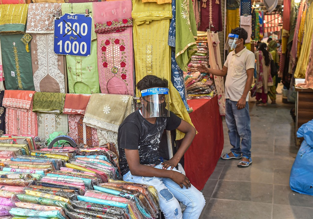 New Delhi: A salesman waits for customers at a garment store in Lajpat Nagar Central Market after authorities eased restrictions, during the ongoing COVID-19 nationwide lockdown, in New Delhi, Tuesday, June 2, 2020. (PTI Photo/Manvender Vashist)(PTI02-06-2020_000236B)