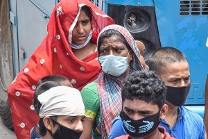 Kolkata: Migrants look for transport to reach their native places after they arrive at Howrah station by train, during the fourth phase of nationwide lockdown to curb the spread of coronavirus, in Kolkata, Saturday, May 30, 2020. (PTI Photo/Swapan Mahapatra)(PTI30-05-2020_000130B)
