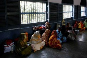Female prisoners sit inside their cell in the eastern Indian city of Kolkata. Credit: Reuters