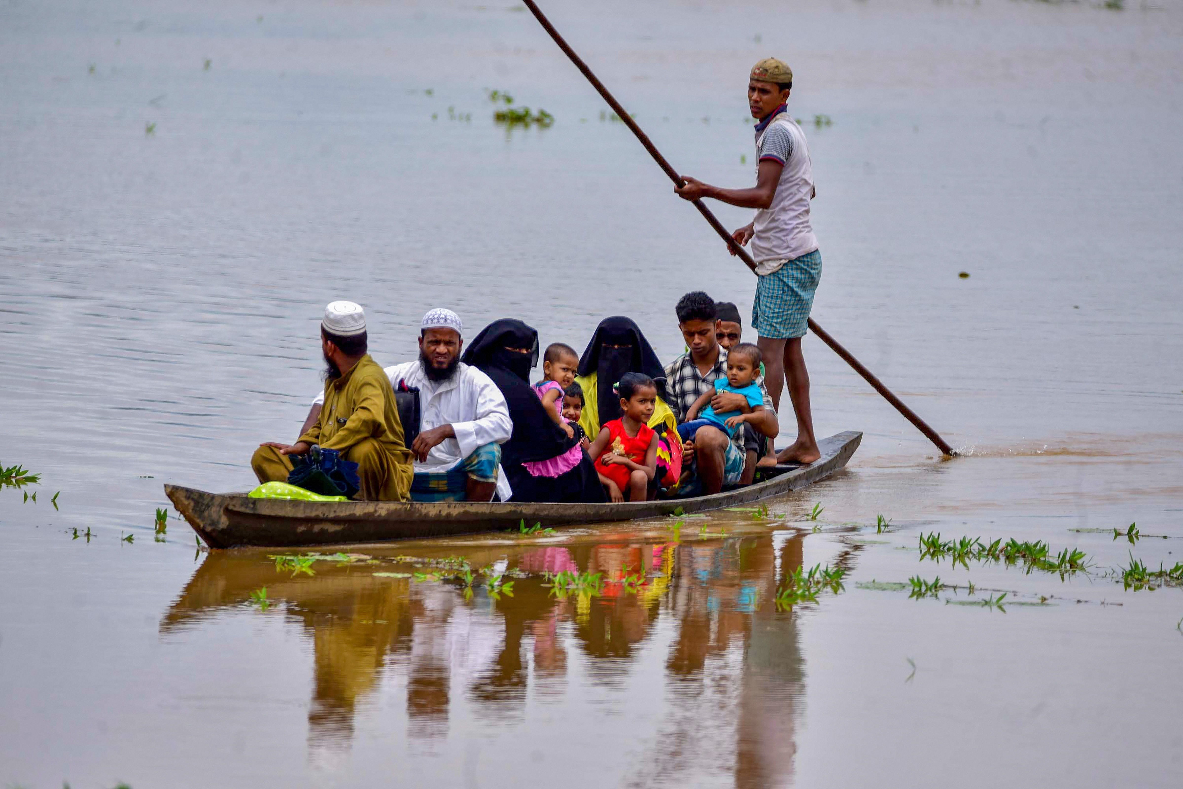 Nagaon: Villagers affected by flood move towards a safer place, in Nagaon district, Wednesday, July 22, 2020. (PTI Photo)(PTI22-07-2020_000220B)