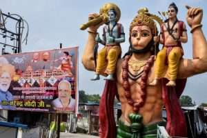 Ayodhya: A hoarding of PM Narendra Modi and other leaders put up beside a statue of Lord Hanuman, ahead of the foundation laying ceremony of Ram Temple, in Ayodhya, Thursday, July 30, 2020. (PTI Photo)(PTI30-07-2020 000044B)