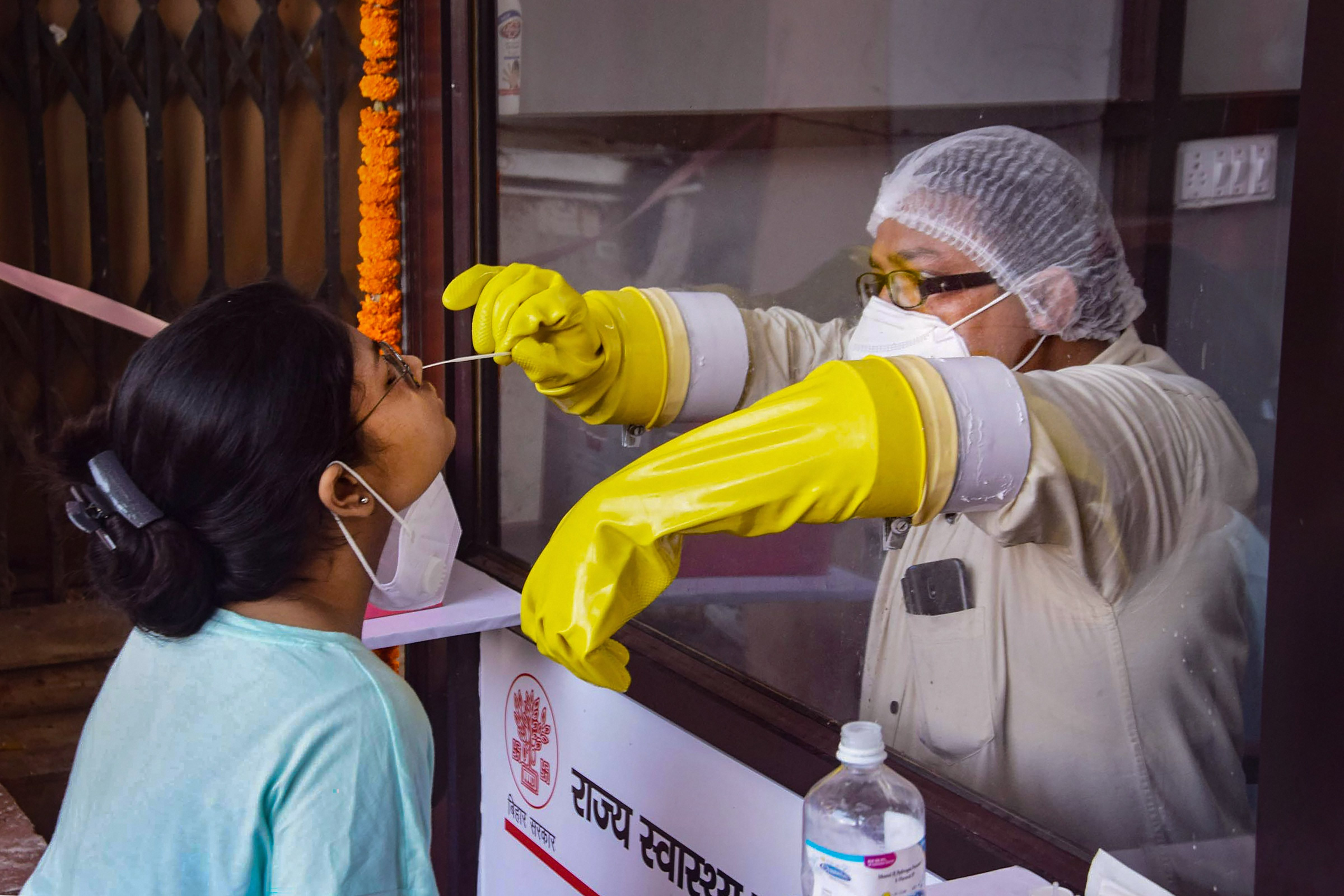 Patna: A medic collects samples for COVID-19 testing during total lockdown, in Patna, Wednesday, July 15, 2020. (PTI Photo)(PTI15-07-2020_000065B)