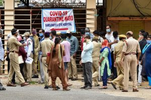 Hyderabad: Police personnel instruct people to maintain social distancing as they wait for their turn to give swab samples for COVID-19 test, outside Sarojini Devi Eye Hospital in Hyderabad, Thursday, July 2, 2020. (PTI Photo)