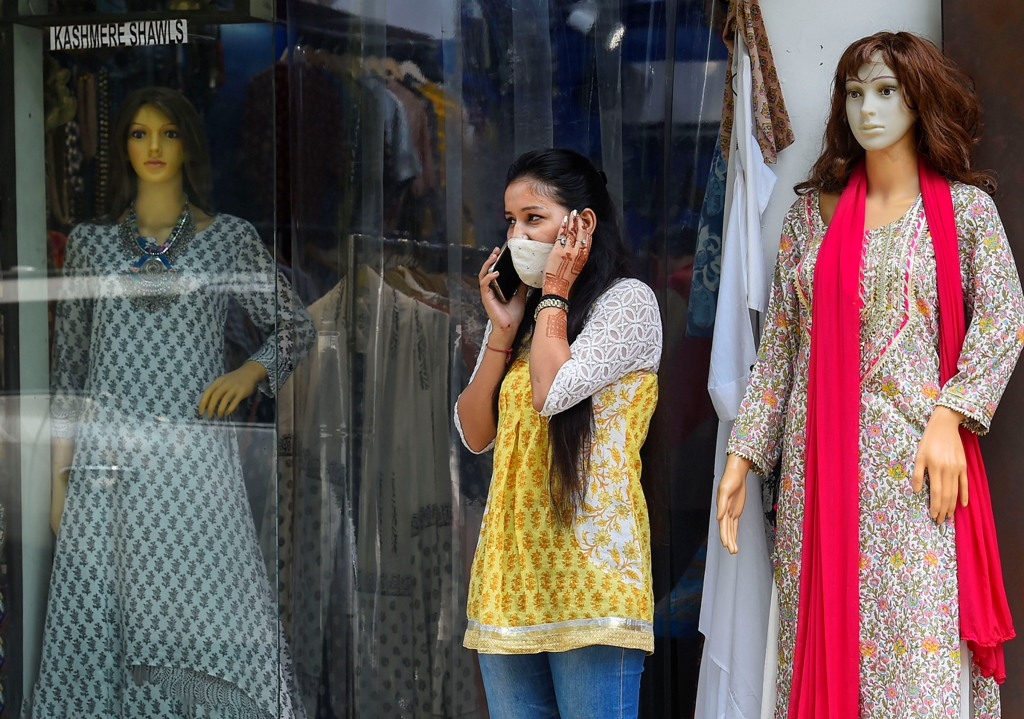 New Delhi: A young woman stands outside a shop at Khan Market during Unlock 2.0, in New Delhi, Thursday, July 2, 2020. (PTI Photo/Kamal Singh)(PTI02-07-2020 000078B)