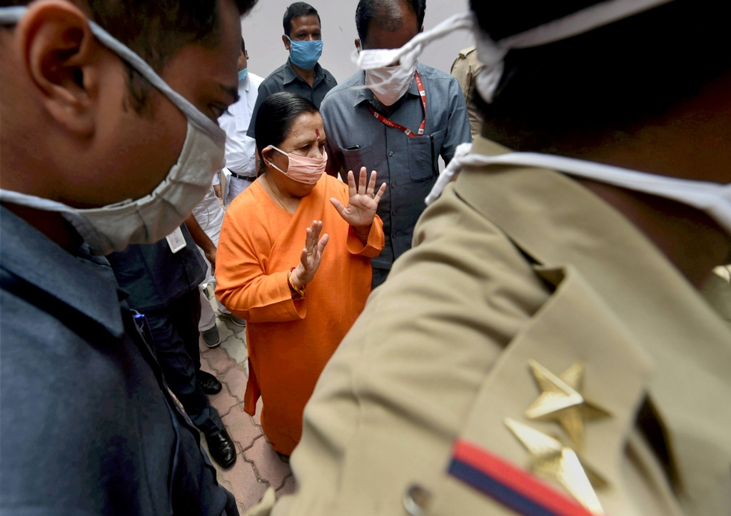 Lucknow: Senior BJP leader Uma Bharti arrives at a special CBI court for a hearing in Babri mosque demolition case, in Lucknow, Thursday, July 2, 2020. (PTI Photo/Nand Kumar) (PTI02-07-2020 000109B)