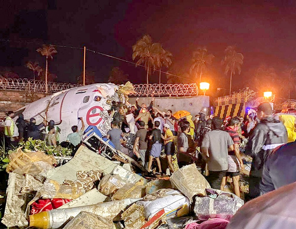 Kozhikode: Rescue operation underway after an Air India Express flight with passengers on board en route from Dubai skidded off the runway while landing, at Karippur in Kozhikode, Friday, Aug. 7, 2020. (PTI Photo)(PTI07-08-2020 000252B)