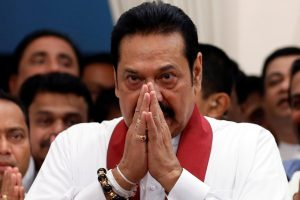 Sri Lanka's newly appointed Prime Minister Mahinda Rajapaksa gestures during the ceremony to assume duties at the Prime Minister's office in Colombo, Sri Lanka October 29, 2018. REUTERS/Dinuka Liyanawatte/Files