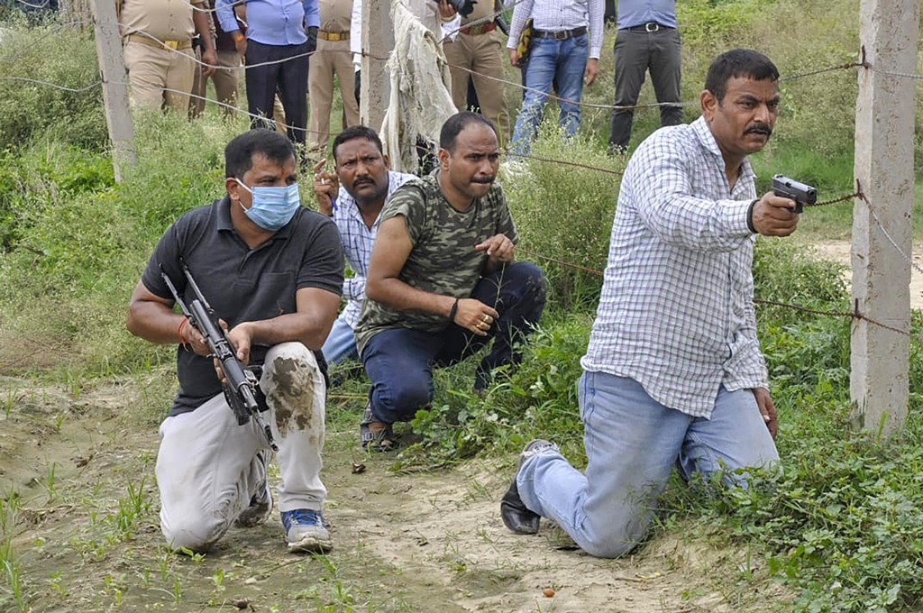 Kanpur: STF and Forensic teams re-enact the events leading to the encounter of slain gangster Vikas Dubey, as part of ongoing investigation of the case, in Kanpur district, Saturday, July 18, 2020. (PTI Photo)(PTI18-07-2020 000067B)