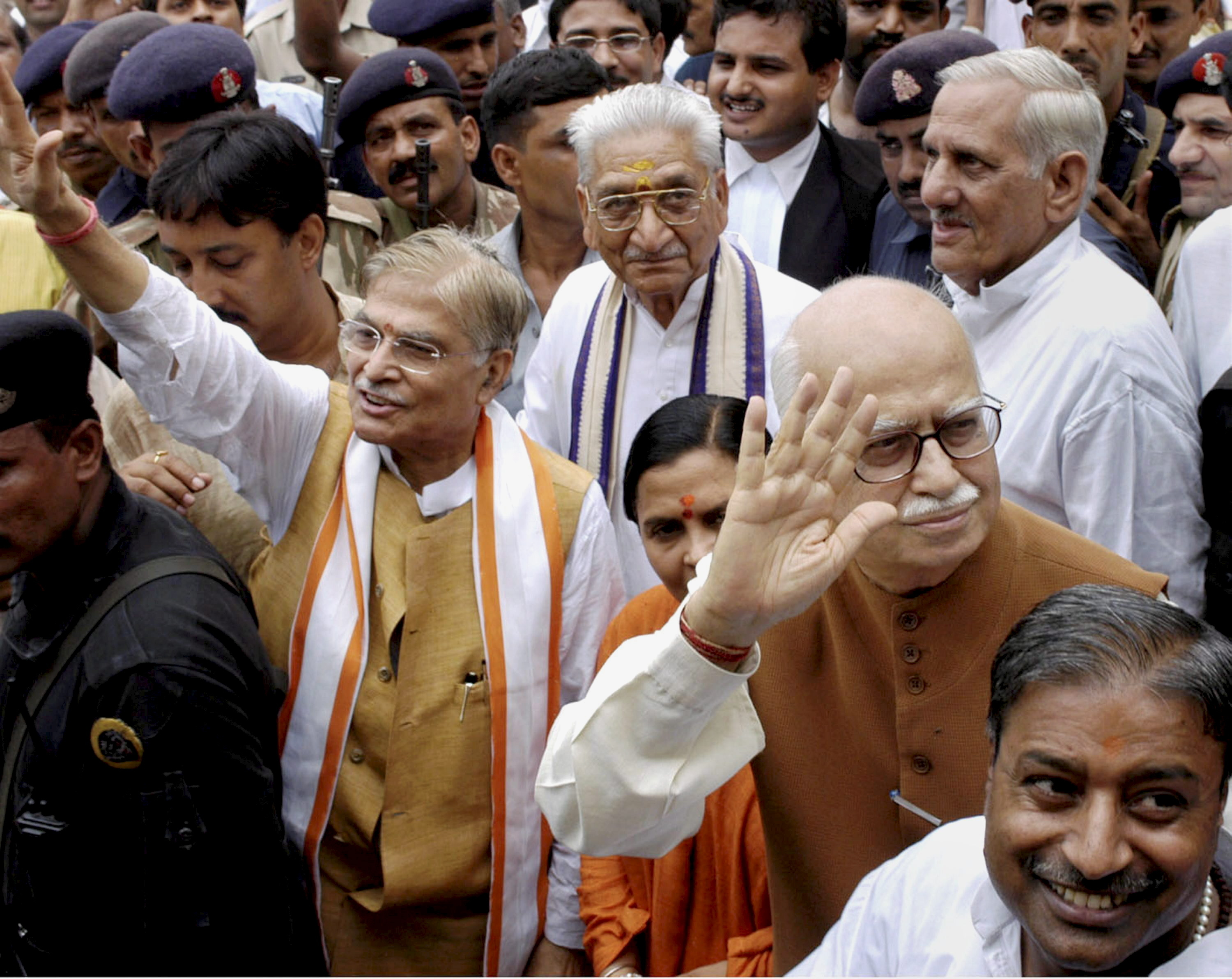 **EDS: FILE** New Delhi: In this file photo, dated July 2005, is seen senior BJP leaders LK Advani, MM Joshi and Uma Bharti in Raebareli. Advani, Joshi and Bharti, accused in Babri mosque demolition case, have been acquitted by the special CBI court after the pronouncement of its judgment in the case, on Wednesday, Sept. 30, 2020. (PTI Photo)(PTI30-09-2020_000047B) *** Local Caption ***